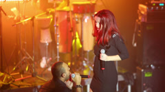 Singer of Arash with russian singer girl sing a song on stage Stock Footage