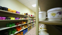 Warehouse with long shelves full of varicolored flowerpot Stock Footage