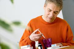 Elderly person taking medication Stock Photos