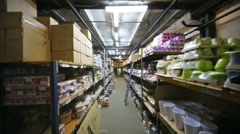 Large warehouse with shelves full of colored flowerpot Stock Footage
