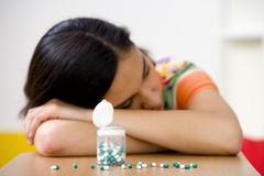 adolescent taking medication - stock photo