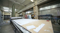 Worker works with milling cutting machine makes plotter cutting Stock Footage