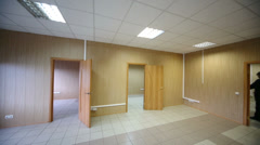 Cleaner work in the large room with three doors and tiled floors Stock Footage