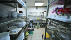 Kitchen at the restaurant with dishes rack and sink for washing - stock footage