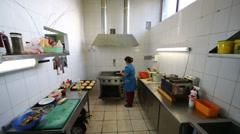 Worker at kitchen of restaurant Pomestie with kitchenware Stock Footage