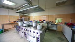 Large kitchen of the restaurant Pomestie with kitchenware Stock Footage