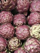 Fresh artichokes for sale at vegetable market 1 Stock Photos