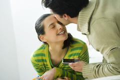 couple in their 20s, inside - stock photo