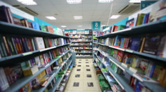 Movement in library with long bookcase and many books Stock Footage