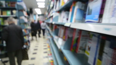 Blur view of library with long bookcase and people Stock Footage