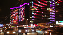 Building with bright multi-colored illumination at night Stock Footage
