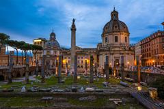 traian column and santa maria di loreto - stock photo