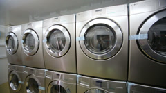 Rows of stainless washing machine in modern laundry Stock Footage