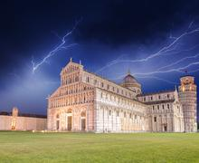 pisa. storm over piazza dei miracoli. miracles square with cathedral detail - stock photo