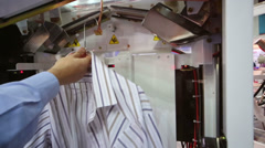 Machine packed shirt the film after cleaning and ironing Stock Footage