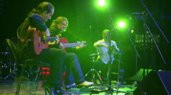 Roman Miroshnichenko plays guitar with musicians Stock Footage
