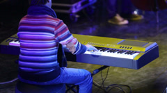 Virtuoso pianist plays the synthesizer on stage Stock Footage