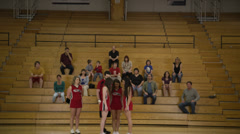 Cheerleaders Lift Girl for Audience Stock Footage