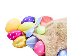 Pile of colorful easter eggs in pouch Stock Photos