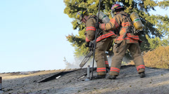 Firefighters On The Roof During A House Fire Stock Footage