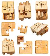 Set of three dimensional wooden mechanical puzzle Stock Photos