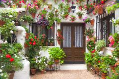 Flowers decoration of vintage courtyard,  spain, europe Stock Photos