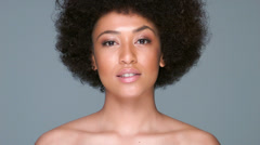 Beautiful woman with an afro hairstyle Stock Footage