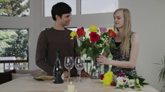 Young Couple Arrange Flowers, Drink Wine - stock footage