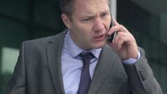 Close Up Of Stressed Businessman Arguing On The Phone. Stock Footage