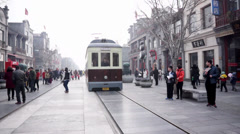 Clang clang tram in Qianmen Street in Beijing Stock Footage
