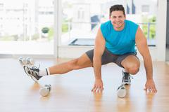 Stock Photo of Portrait of a sporty man doing stretching exercise