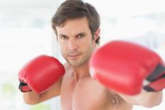Closeup portrait of a determined male boxer - stock photo