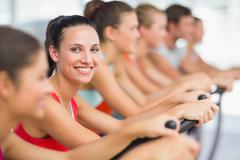 Stock Photo of Fit people working out at spinning class