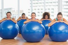 Portrait of smiling people with exercise balls - stock photo