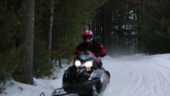 SNOWMOBILING ON A TRAIL Stock Footage