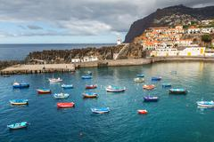 madeira, port with boats and houses - stock photo