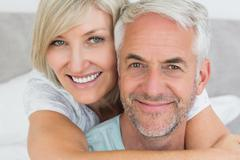Closeup of a loving mature couple in bed - stock photo