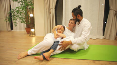 Couple with baby in yoga centre Stock Footage