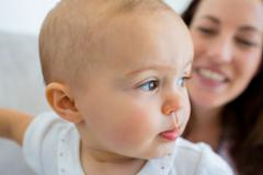 Closeup of a smiling cute baby - stock photo