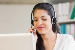 Stock Photo of Call center representative using headset