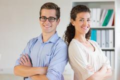 Confident business people in office - stock photo