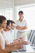 Female manager working in a call center - stock photo