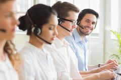 Business people working in call center - stock photo