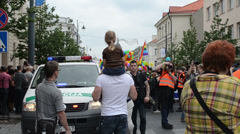 Police force look public order and photographer in gay parade Stock Footage