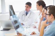 Stock Photo of Medical team analyzing Xrays