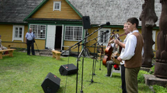 Man country band play folk music and people audience enjoy show Stock Footage