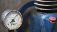 Stock Video Footage of pressure gauge with compressor working.