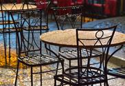 Stock Photo of tables at an outdoor cafe in the rain