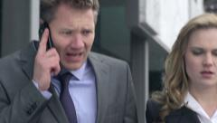 Slow Motion Of Business Team Walking And Arguing On Phone. Close-Up. - stock footage