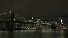 Time lapse of Manhattan and the Brooklyn Bridge in New York City at night - stock footage